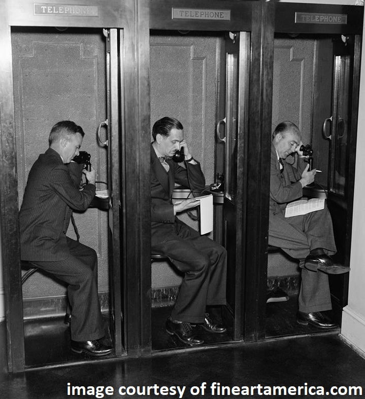 reporters-in-telephone-booths-in-white-everett