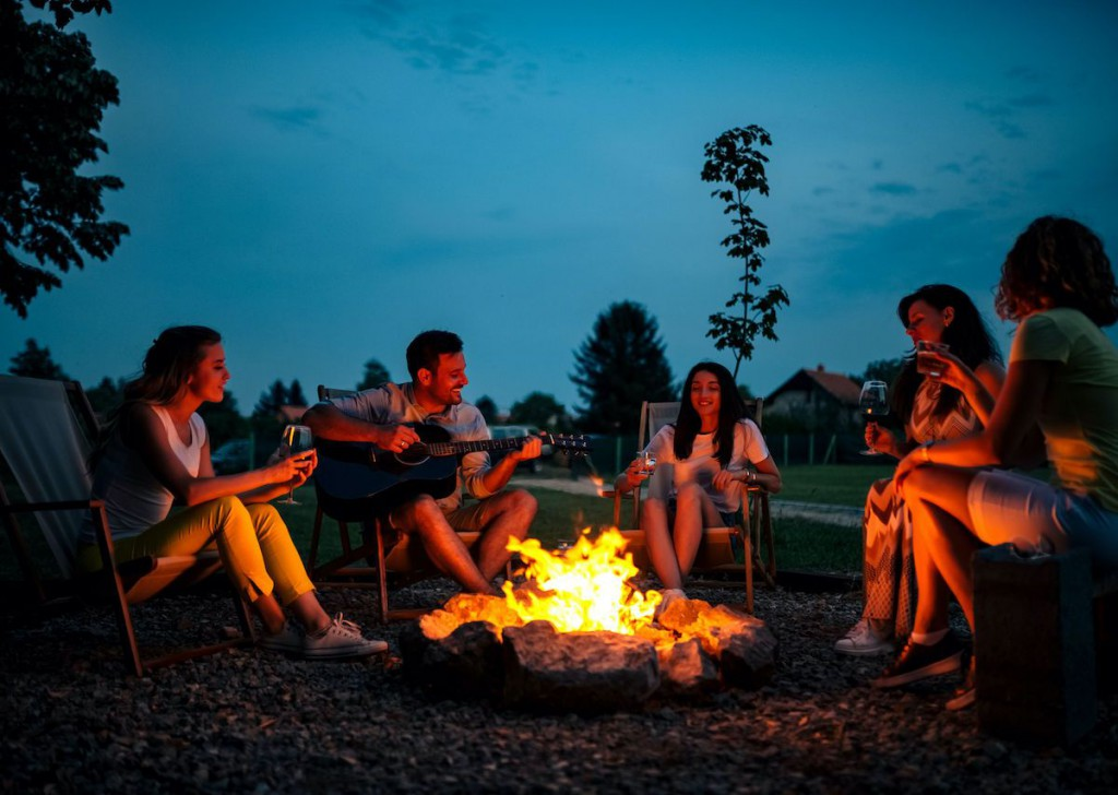people-singing-around-a-campfire-1200x854